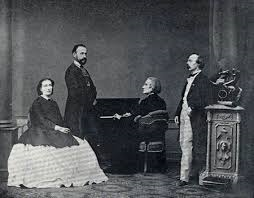 Cosima, H. W. Ernst, Franz Liszt and Hans von Bülow (1865) in Pest. The real marriage wrecking 'pest', Wagner, was absent from the picture.